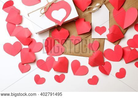 White Gift Box With Red Label In A Heart Form, Gift Wrapped In Brown Craft Paper, Tied With Twine Wi