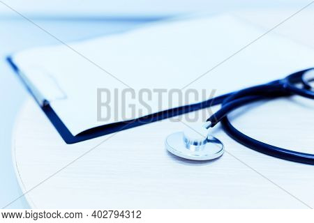 Stethoscope For Doctor Checkup On Health Medical Laboratory Table Background.