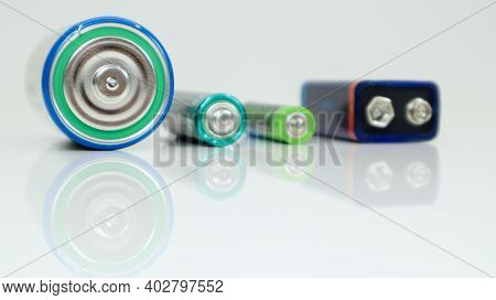 Battery Type D Or C, Pp3, Aa, Aaa On A White Background With Reflection. View Of Metal Alkaline Batt