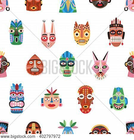 Seamless Pattern Of Funny Ethnic Tribal Masks Isolated On White Background. Ancient African Bright C