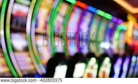 Defocused Slot Machines Glow In Casino On Fabulous Las Vegas Strip, Usa. Blurred Gambling Jackpot Sl