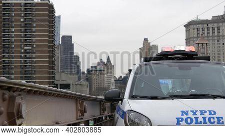 New York City, Usa - 12 Mar 2020: Emergency Siren Glowing, 991 Police Patrol Car On Brooklyn Bridge.
