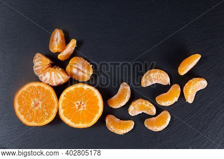 Citrus Mandarins Top View. Peeled Mandarins. Mandarin Juicy Ripe Fruit.