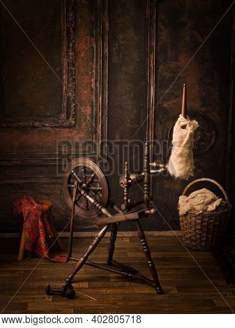 Still life image of an authentic old spinning wheel with real sheep wool