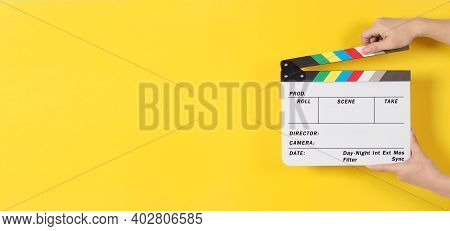 Hand Is Holding Clapper Board Or Movie Slate Or Film Slate.it Is Used In Video Production And Cinema