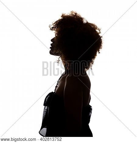 Shaded silhouette of a young African woman against a white background. The woman is standing sideways and you can see her profile.