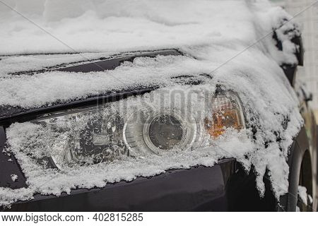 Snow-covered Frozen Car Covered With Snow. Winter Road. Danger Of Winter Driving. Car Snow Removal.