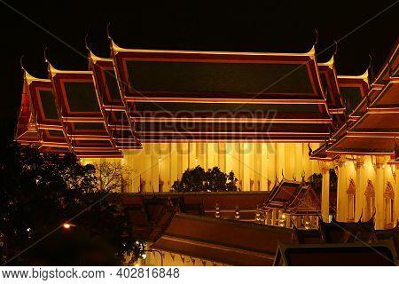 Stunning Aerial View Of The Ordination Hall Of Wat Suthat Thepwararam Temple In Bangkok At Night, Hi