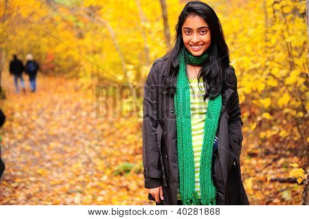 Indian girl enjoying autumn