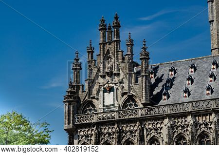 Middelburg, Netherlands, August 2019. Details Of The Magnificent Gothic Style Town Hall, Beautiful S