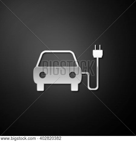 Silver Electric Car And Electrical Cable Plug Charging Icon Isolated On Black Background. Electric C