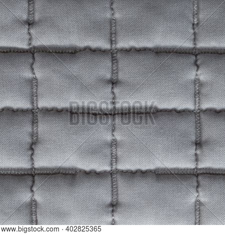 Sewed Quilt Blanket Patchwork Blanket Texture. Gray Quilted Cotton Duvet Embroidery Macro. Soft Sewi