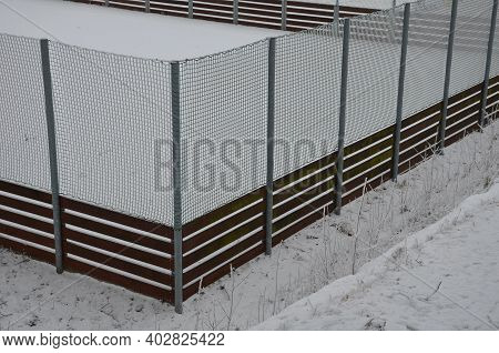 Purpose Sports Field, Has Nets And Wooden Guardrails On The Edges. In Height It Is Boundary By A Net