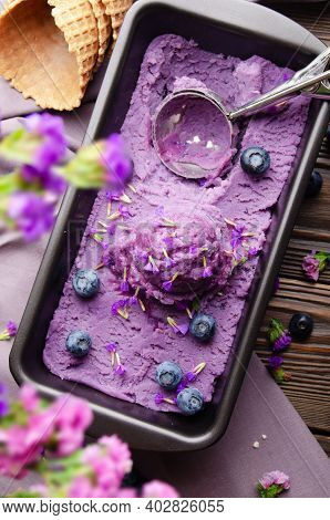 Flat Lay View At Blackberry Icecream In Metal Tray Served With Flower Buds And Blackberries On Kitch