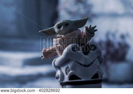 JAN 10 2021: Disney Plus series the Mandalorian - Grogu (baby Yoda or the child) in a Stormtrooper helmet - Hasbro action figures