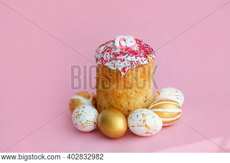 Easter Cakes - Traditional Kulich And Golden Eggs On A Pink Background. Paska Easter Bread In Russia