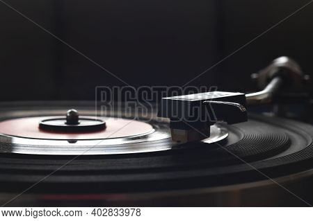 Close Up Of Turntable Neede On A Vinyl Record. Turntable Playing Vinyl Record