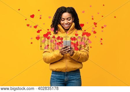 Happy African Woman Using Phone Sending Hearts And Like Icons Texting On Valentines Holiday In Onlin