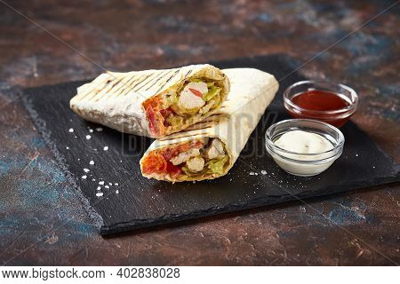 Eastern Traditional Shawarma With Chicken And Vegetables, Doner Kebab With Sauces On Slate. Fast Foo