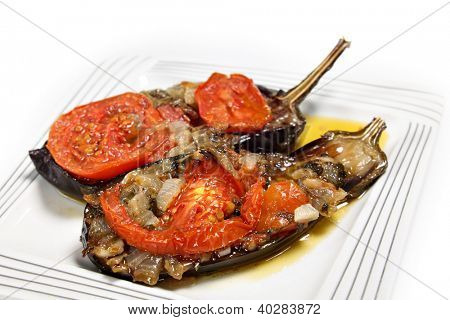 Imam balidi or Imam melitzanes, a delicious Greek or Turkish vegetarian dish of eggplant (aubergine) stuffed with onion, garlic, parsley and tomato and baked in virgin olive oil.