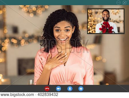 Long Distance Relationship. Surprised African American Woman In Dress Making Online Video Call With