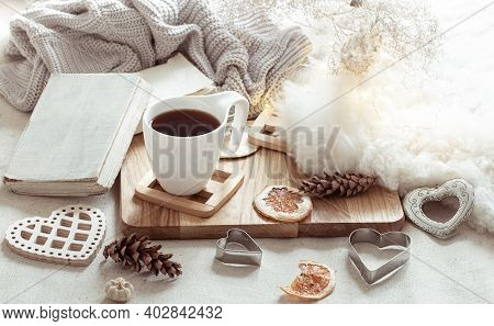 A Cup Of Hot Drink And Cute Home Decor Items. The Concept Of Home Comfort And Aesthetics.