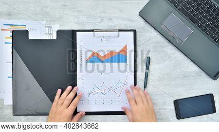 Businessman Hands Checking Business Profits. Paperwork And Financial Success Concept. Close Up