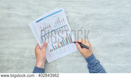 Top View Of Businessman Analyzing Financial Results. Finance And Trade Concept. Close Up