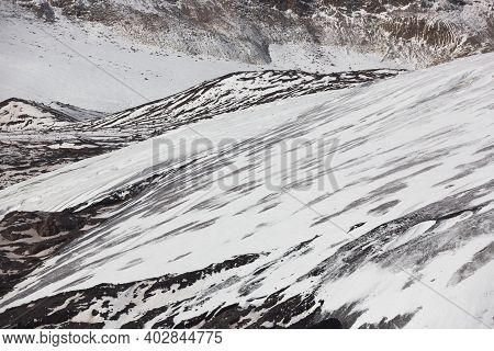 Snow-capped Slopes. Winter Mountains, Alpine Skiing. Sunny Snowy Landscape. Panoramic Mountain View.