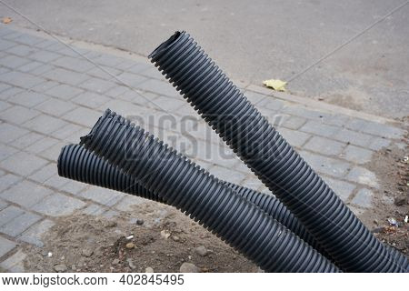 Pipes Protrude From The Pavement, Unfinished Construction Of Underground Corrugated Pipes, Unburied