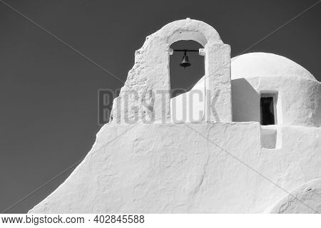 Dome and belfry of Panagia Paraportiani church in Mykonos island, Greece. Black and white architectural photography