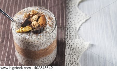 Chia Pudding With Cocoa, Chocolate And Nuts In Almond Milk