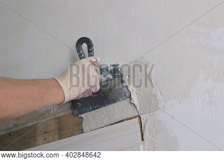 Stage Of The Process Of Leveling The Wall Next To The Doorway After Installing The Door Frame, The H
