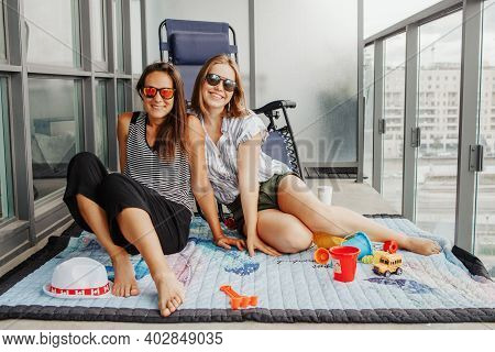 Young Lesbian Lgbtq Women Family Spending Time Together On Balcony At Home. Happy Women Smiling Fema