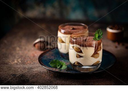 Traditional Italian Dessert Tiramisu In A Glass On On Dark Background