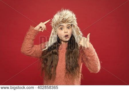 Look At This. Warm Hat For Cold Weather. Girl Wear Hat With Ear Flaps White Background. Soft Furry A