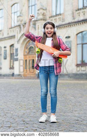 Skateboard Competition Winner. Happy Child Skateboarder Make Winner Gesture. Riding Penny Board. Str