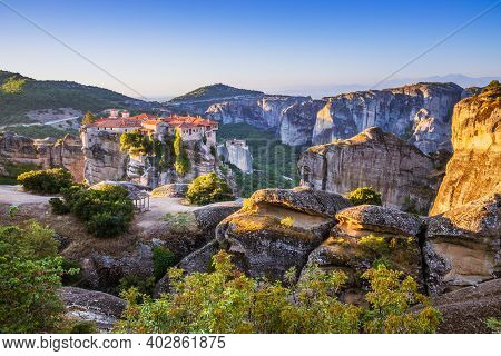Meteora, Greece. Sandstone Rock Formations And  Monastery Varlaam At Sunrise.