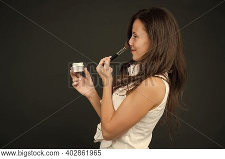 Mineral Foundations. Mineral Powder. Sensual Woman With Long Hair Apply Powder On Face. Beauty Salon