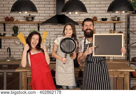 Cooking Together. Recipe Copy Space. Family Restaurant Concept. Best Cooking Team. Mom Dad And Daugh