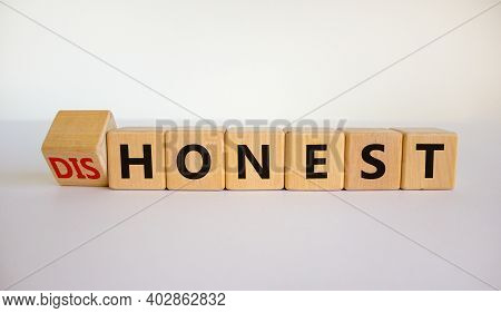 Honest Or Dishonest Symbol. Turned Cube And Changed The Word 'dishonest' To 'honest'. Beautiful Whit