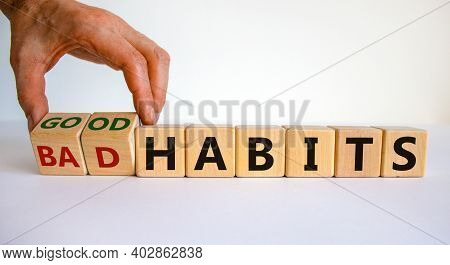 Good Or Bad Habits Symbol. Businessman Hand Turns Wooden Cubes And Changes Words 'bad Habits' To 'go