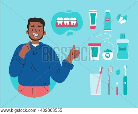 Man Showing His Smile With Dental Braces. Attractive Guy With Various Accessories For Daily Dental C