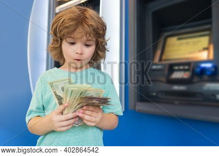 Kids Banking And Finance. Piggy Bank Investments. Saving Money. Child With Dollars