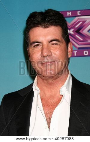 LOS ANGELES - DEC 19:  Simon Cowell at the 'X Factor' Season Finale performances  show taping at CBS Television City on December 19, 2012 in Los Angeles, CA