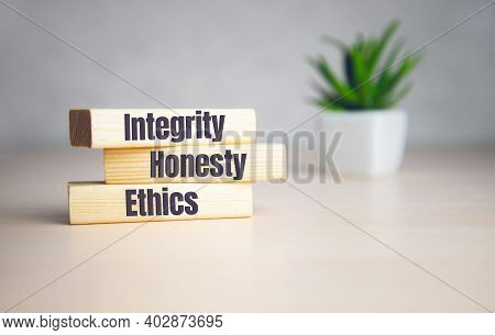 Wooden Cubes With Text Integrity, Honesty, Ethics. Diagram And White Background.