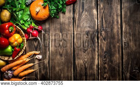 Organic Vegetables. Different Raw Vegetables . On Wooden Background