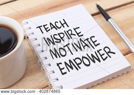 Teach Inspire Motivate Empower, Text Words Typography Written On Paper Against Wooden Background, Li