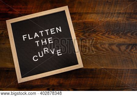 Flatten The Curving Curve Copy Space On Wooden Background