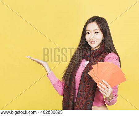 Young Asian Woman Showing The Red Envelope For Celebrating Chinese New Year